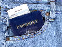 Passport and Boarding Pass in Jeans Pocket. Passport and boarding pass sticking out of blue jeans pocket Royalty Free Stock Photos