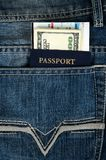 Passport with boarding pass and money in jeans Royalty Free Stock Image