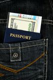 Passport with boarding pass and money in jeans Stock Photos
