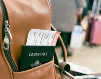 Passport with boarding pass in the backpack pocket. Passport with boarding pass in the pocket of a leather backpack at the airport Royalty Free Stock Photos