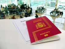 Passport and boarding pass, waiting for a flight in an airport Stock Images