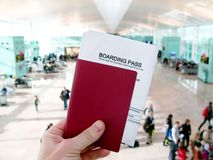 Passport and boarding pass, waiting for a flight in an airport Royalty Free Stock Photo