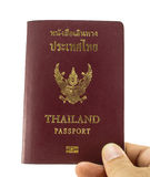 Passport book for Thai people. Legal passport book for Thai people with white back ground  hold in the right hand Royalty Free Stock Photography