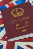 Passport on Britsh flag. Finance and travel conceptual image. Money and passport on white back ground Stock Photos