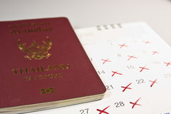 Passport and calendar holiday vacation. Royalty Free Stock Photography