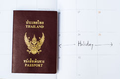 Passport on the calender with vacation text Royalty Free Stock Image