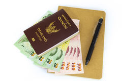 Passport, cash, pen and book. Royalty Free Stock Image