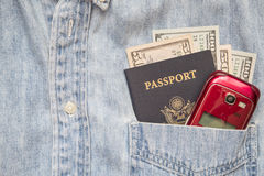 Passport cash shirt pocket cellphone travel wealth Stock Photos