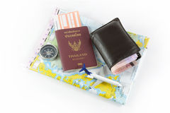Passport ,compass, airplane , orb and money  ,journey concept Stock Photos