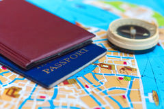 Passport and compass on a map Royalty Free Stock Photography