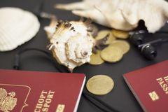 Passport, credit card, travel accessories, seashells. Vacation documents. Turism concept. Selective focus. Passport, credit card prepared for trip, travel Stock Photo