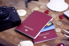 Passport, credit card, travel accessories, seashells. Vacation documents. Turism concept. Selective focus. Passport, credit card prepared for trip, travel Royalty Free Stock Images