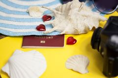 Passport, credit card, travel accessories, seashells. Vacation documents. Turism concept. Selective focus. Passport, credit card prepared for trip, travel Royalty Free Stock Image
