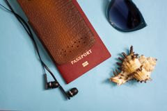 Passport, credit card, travel accessories, seashells. Vacation documents. Turism concept. Selective focus. Passport, credit card prepared for trip, travel Stock Images