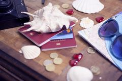 Passport, credit card, travel accessories, seashells. Vacation documents. Turism concept. Selective focus. Passport, credit card prepared for trip, travel Stock Image