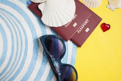 Passport, credit card, travel accessories, seashells. Vacation documents. Turism concept. Selective focus. Passport, credit card prepared for trip, travel Royalty Free Stock Photo