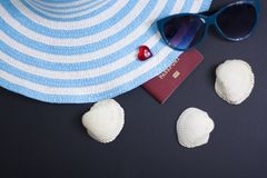 Passport, credit card, travel accessories, seashells. Vacation documents. Turism concept. Selective focus. Passport, credit card prepared for trip, travel Royalty Free Stock Photos