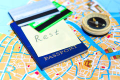 Passport, credit cards and compass on a map Stock Photo