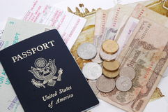 Passport and Currency. Passport, money, boarding pass, visa receipt royalty free stock photo