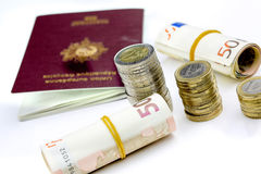 Passport and currency focuses on Euro banknotes Royalty Free Stock Photography
