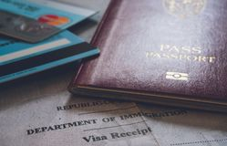 Passport document, banking cards and Immigration card receipt. royalty free stock photos