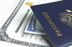 Passport and documents. Blue American passport with citizenship documents on white background Royalty Free Stock Photos