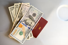 Passport with dollar money staying on table seat Royalty Free Stock Photo