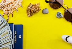 Passport, dollars, cosmetics, seashell. Preparing for the trip. stock photos