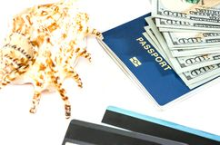 Passport, dollars, shell, cards on white royalty free stock photos