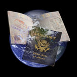 Passport earth. Transparent open and closed passports superimposed over the earth Stock Photo