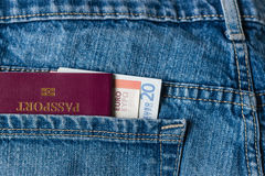 Passport and Euro banknotes in jeans pocket Stock Photo