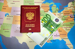 Passport with Euro bill on the map. Euro bills in the passport on the map stock image