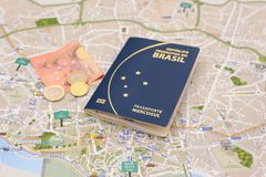 Brazilian passport, euros and map for travel abroad. Passport, euros and map for travel abroad. Brazilian passport and map of the city of Porto in Portugal Stock Image