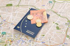 Brazilian passport, euros and map for travel abroad. Passport, euros and map for travel abroad. Brazilian passport and map of the city of Porto in Portugal Stock Photo
