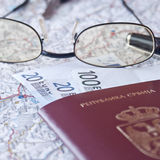 Passport, eyeglasses and money. On the map Stock Photography