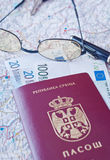 Passport, eyeglasses and money. On the map Stock Photo
