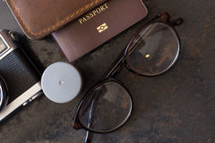 Passport with a film camera , tour arrangements. Stock Images