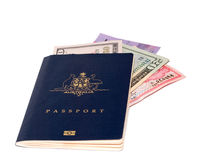 Passport with foreign currency. An Australian Passport with various currency. Can be used for the concept of foreign exchange, currency exhcange, travellers Stock Photo