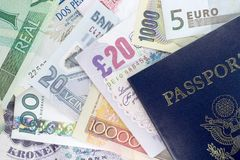 Passport and Foreign Currency. US Passport and assorted currencies from around the world Stock Photography