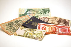 Passport and Foreign Currency 2. Image of a US passport and foreign currency Royalty Free Stock Image