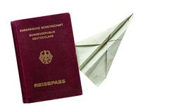 Passport from Germany and paper airplane isolated on white Royalty Free Stock Photos