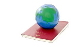Passport with global model toy Stock Image