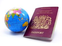 A passport with a globe Royalty Free Stock Image