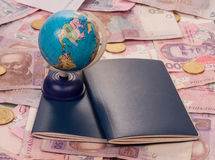 Passport and globe on money Stock Photos