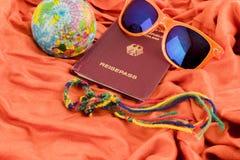 Passport, Globe and Sunglasses on Orange Blanket Stock Images