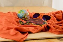 Passport, Globe and Sunglasses on Orange Blanket Stock Photo
