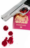 Passport and gun with blood splatters. A hand Gun and a passport set on a white isolated background base with blood splatters to the foreground Royalty Free Stock Photos