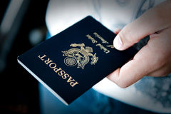 Passport in hand Stock Photos