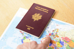 Passport and hand with finger that show countries. Passport and hand with finger stock image