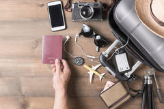 Passport in hand man with suitcase and accessories royalty free stock photography